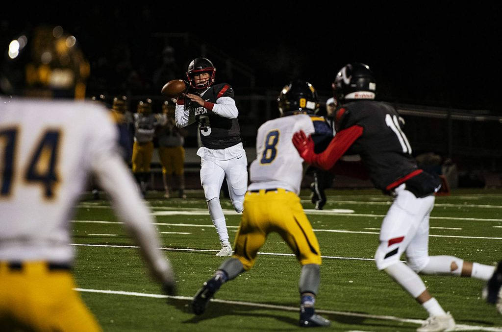 Aspen High School's quarterback Tyler Ward (3) looks for an open pass during the game against Rifle High School on Friday, October 18, 2019.