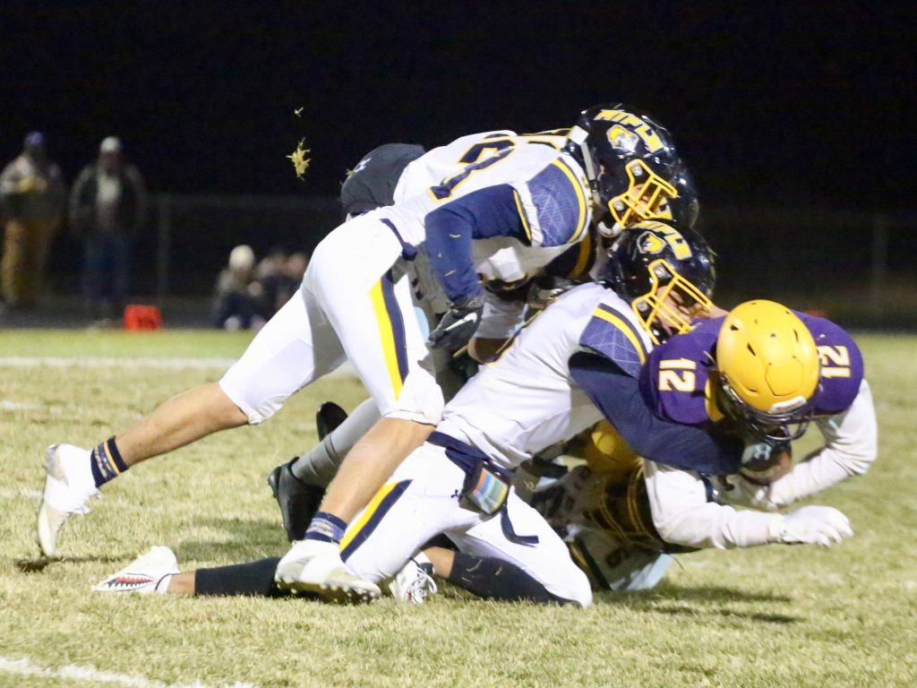 Basalt High School receiver Jackson Rapaport is gang tackled by a host of Rifle defenders on Friday, Oct. 25, 2019, in Basalt. (Photo by Austin Colbert/The Aspen Times)