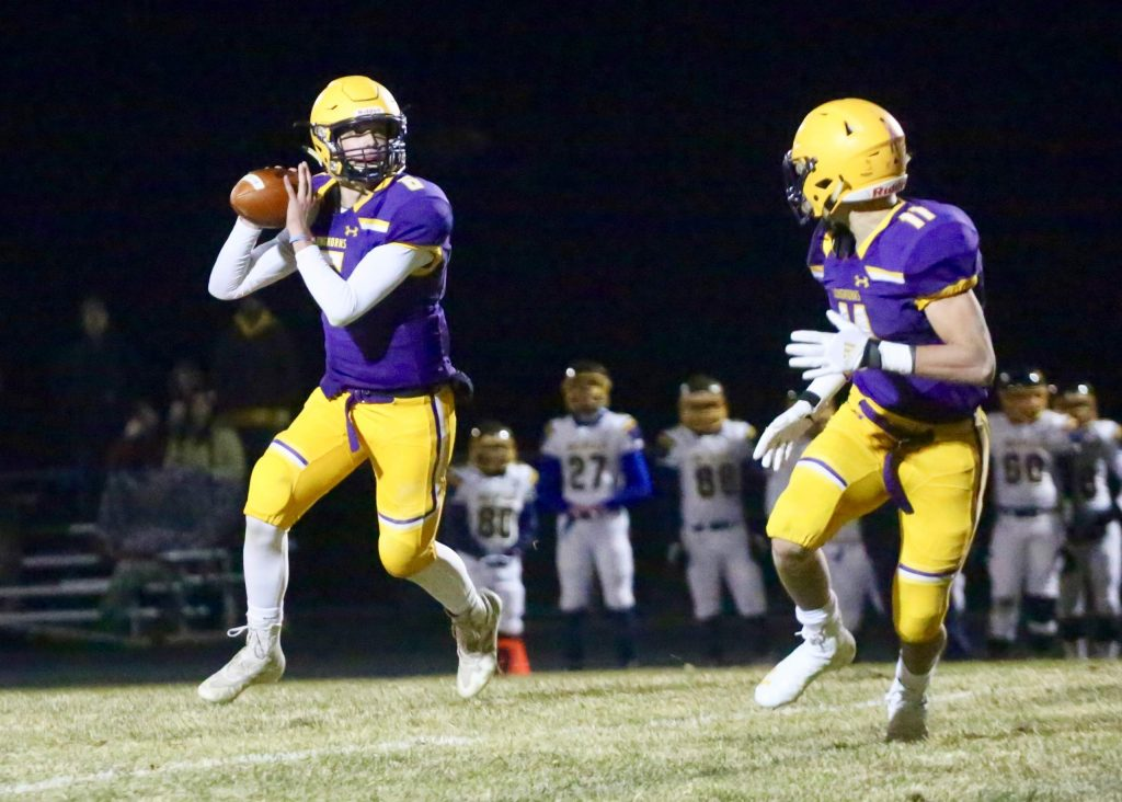 Basalt High School quarterback Matty Gillis, left, looks for a target against Rifle on Friday, Oct. 25, 2019, in Basalt. (Photo by Austin Colbert/The Aspen Times)