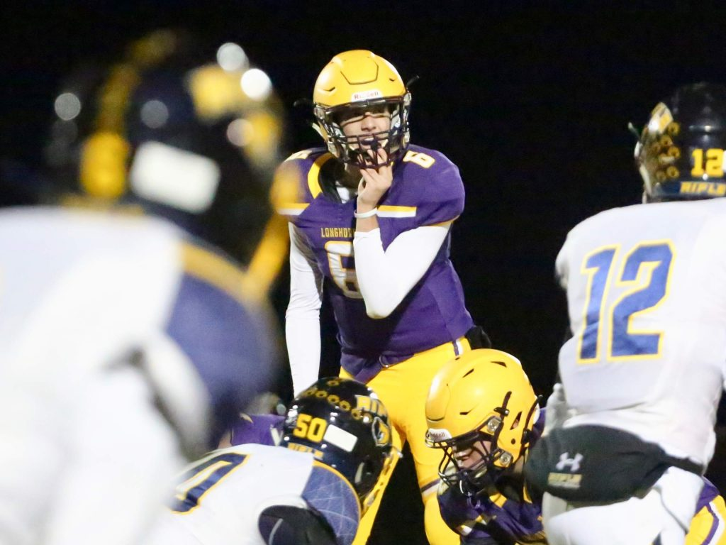 Basalt High School quarterback Matty Gillis makes some pre-snap adjustments against Rifle on Friday, Oct. 25, 2019, in Basalt. (Photo by Austin Colbert/The Aspen Times)