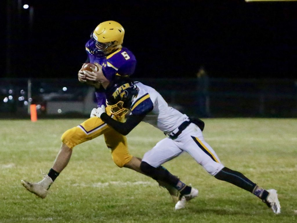 Basalt High School's Tristan Johnston is hit after making a catch against Rifle on Friday, Oct. 25, 2019, in Basalt. (Photo by Austin Colbert/The Aspen Times)