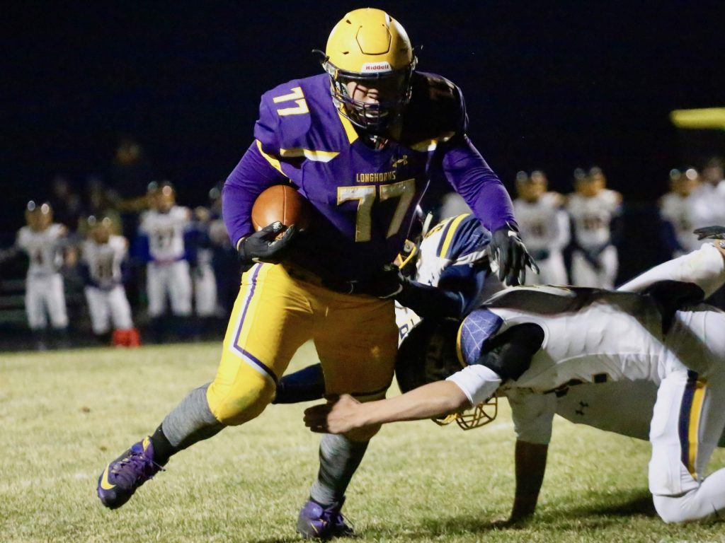 Basalt High School lineman Ernesto Lopez gets a rare offensive carry against Rifle on Friday, Oct. 25, 2019, in Basalt. (Photo by Austin Colbert/The Aspen Times)