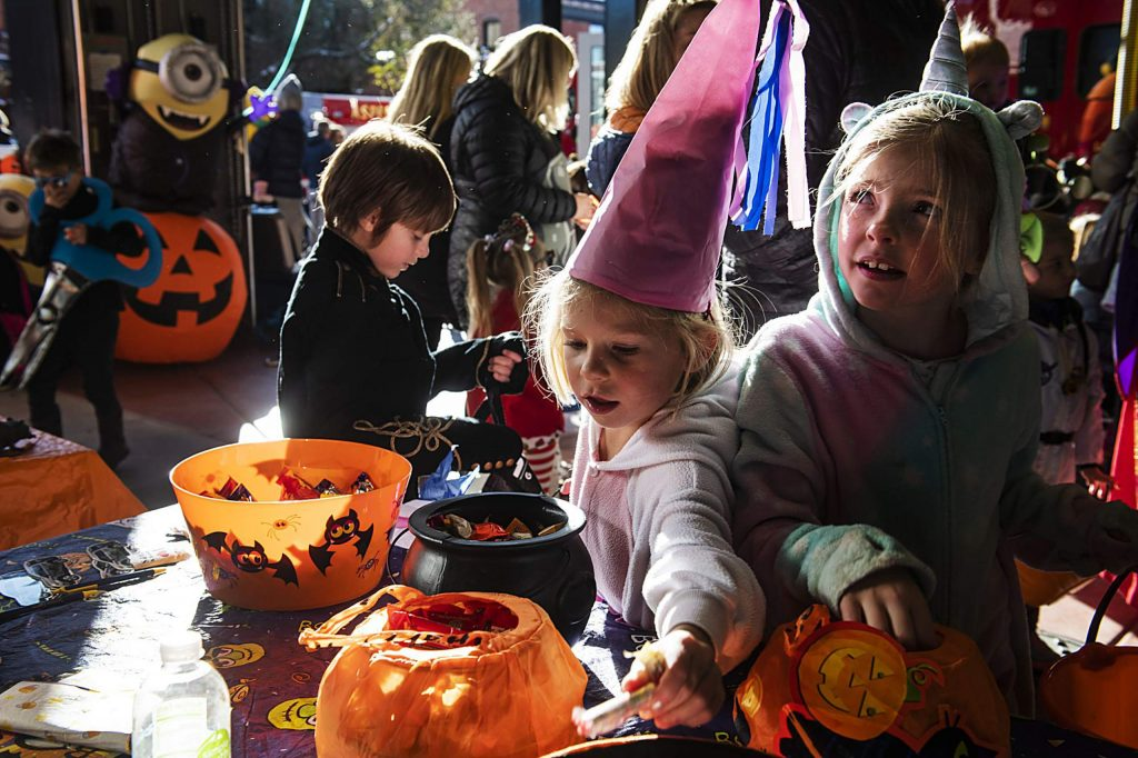 Kids take candy during the Boo Bash at the Aspen Volunteer Fire Department on Thursday, October 31, 2019. (Kelsey Brunner/The Aspen Times)