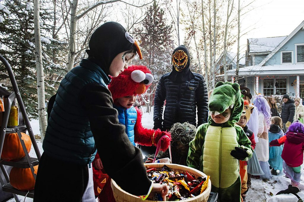 Gavin Longnecker, 2, trick-or-treats at the Maloof Wood Barn during the Anderson Ranch Spooktacular in Snowmass on Wednesday, October 30, 2019. (Kelsey Brunner/The Aspen Times)