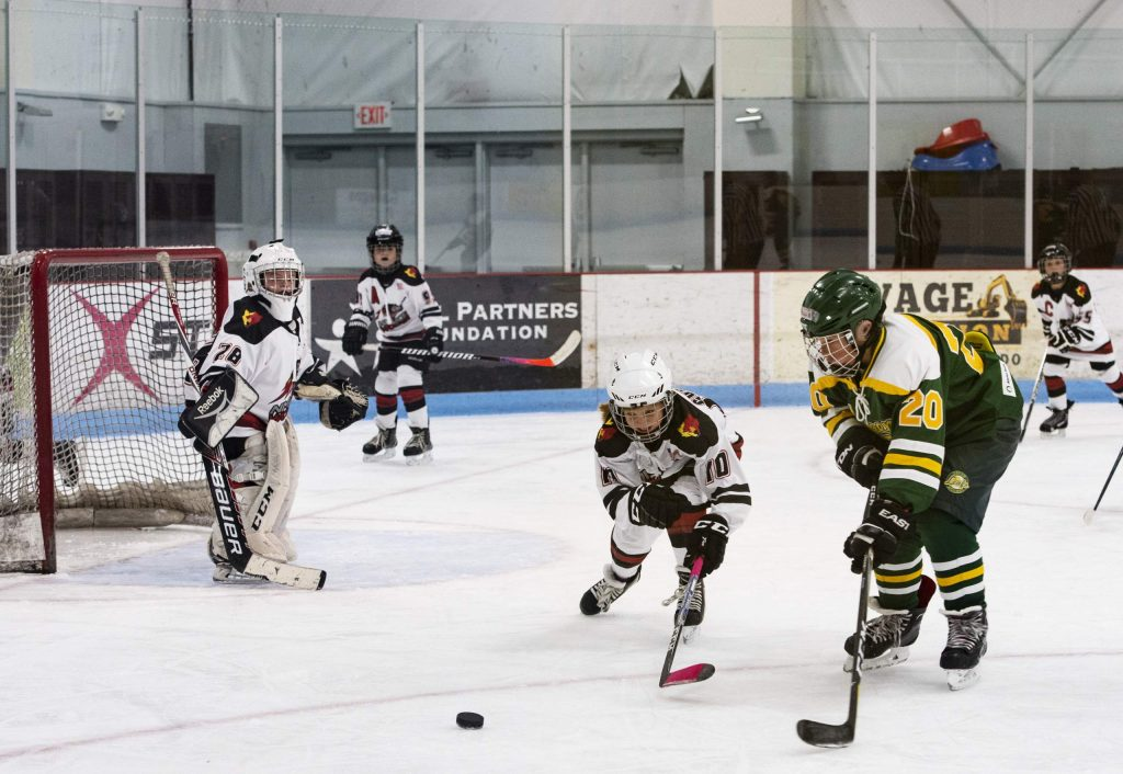 Aspen Leafs make their way to goal during the Squirt A game against New Mexico at the 26th Annual Aspen Fall Face-off Tournament in Lewis Arena at the Aspen Recreation Center on Friday, October 25, 2019. The Aspen Leafs won the game 4-2. (Kelsey Brunner/The Aspen Times)
