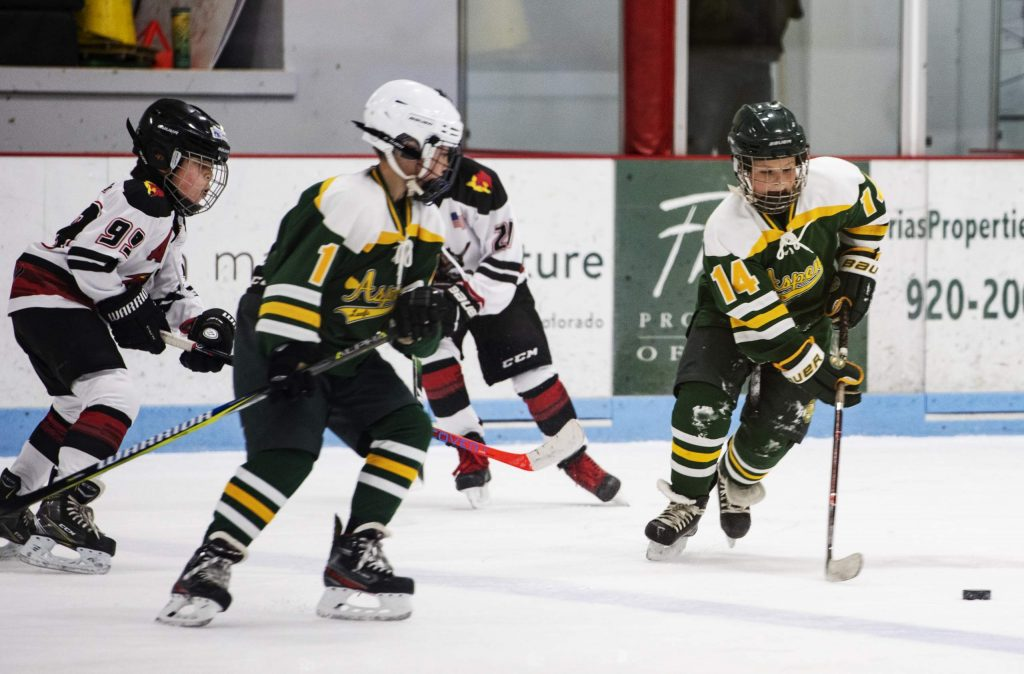 Aspen Leafs play offense during the Squirt A game against New Mexico at the 26th Annual Aspen Fall Face-off Tournament in Lewis Arena at the Aspen Recreation Center on Friday, October 25, 2019. The Aspen Leafs won the game 4-2. (Kelsey Brunner/The Aspen Times)