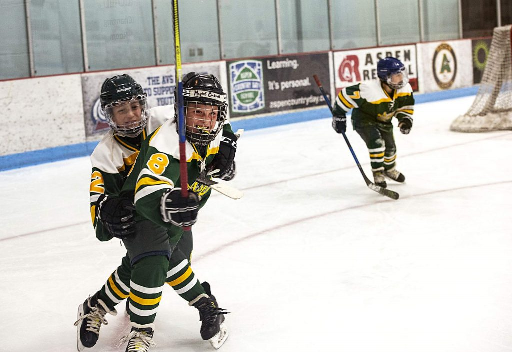 Aspen Leafs Magnus Carlson, 9, center, celebrates with his teammates after scoring the fourth goal of the Squirt A game against New Mexico during the 26th Annual Aspen Fall Face-off Tournament in Lewis Arena at the Aspen Recreation Center on Friday, October 25, 2019. The Aspen Leafs won the game 4-2. (Kelsey Brunner/The Aspen Times)