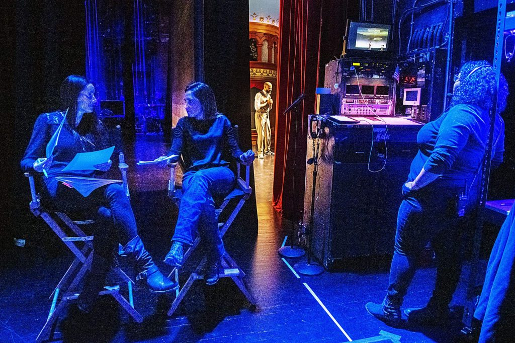 Keyon Dooling, center, speaks to an audience about mental health while Lady Fuller, left, Christina King talk backstage while stage manager Jessie Douglas monitors the event during the 5th annual Changing Brains Changing Lives symposuium at The Wheeler on Tuesday, October 22, 2019. (Kelsey Brunner/The Aspen Times)