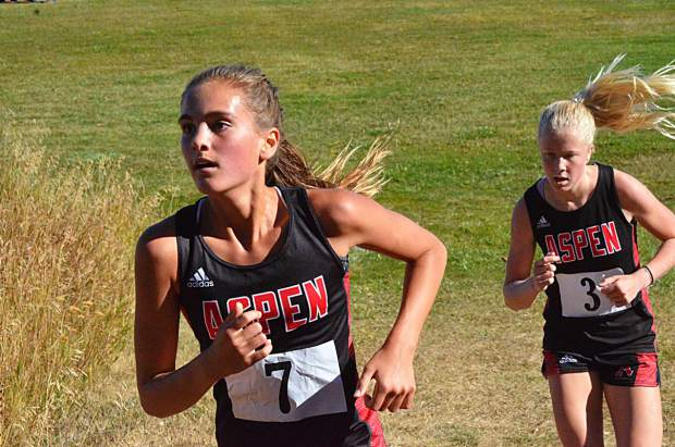 Aspen High School's Kylie Kenny, left, and Kendall Clark compete in Moffat County's cross country meet earlier this season in Craig. (Photo by Andy Bockelman/Craig Press)