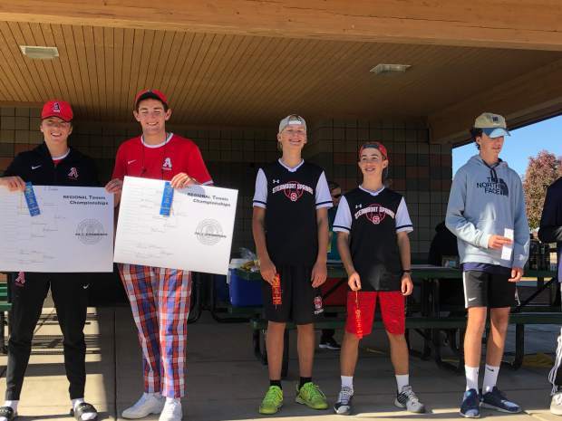 Aspen's No. 2 doubles team of Bryce Cordts-Pearce and Robert Holton on the podium after winning their boys tennis regional on Friday, Oct. 11, 2019, in Grand Junction.