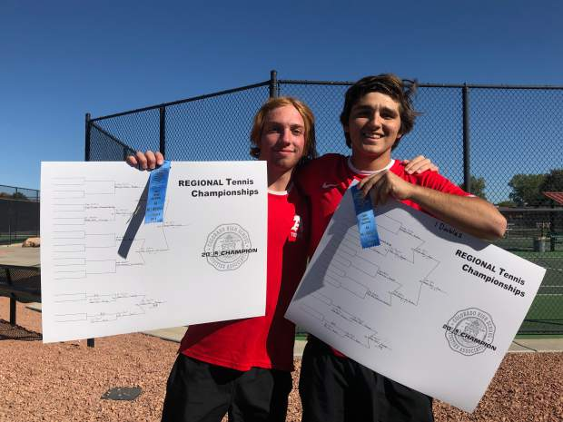 Aspen's No. 1 doubles team of Lukee Tralins, left, and Georges Ghali after winning their boys tennis regional on Friday, Oct. 11, 2019, in Grand Junction.
