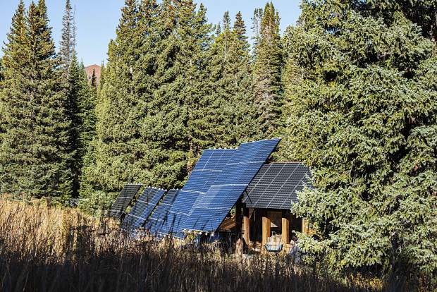 A bank of solar panels provides power for an off-grid home at the top of Little Annie Road.