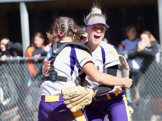 Basalt High School softball pitcher Maya Lindgren, right, hugs catcher Zoe Vozick after the team beat Lamar for the regional championship on Saturday, Oct. 19, 2019, on the BHS field. (Photo by Austin Colbert/The Aspen Times)