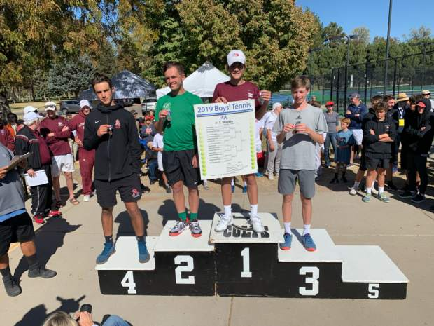 Aspen's Liam Sunkel stands on the podium after finishing fourth in the No. 3 singles flight at the Class 4A state tennis tournament on Saturday in Pueblo.