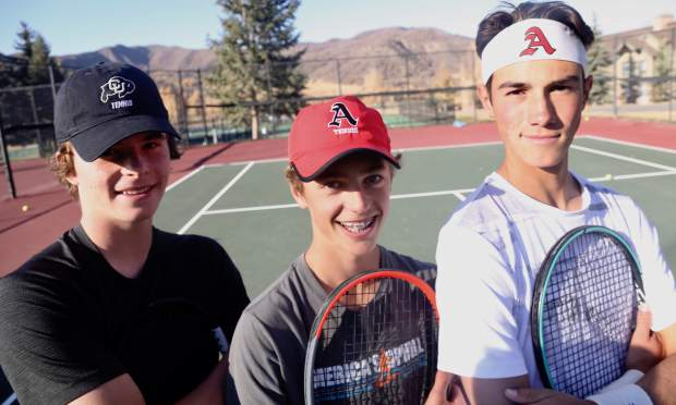 Aspen High School tennis singles players, from left, Alex Mosher, Christian Kelly and Liam Sunkel pose during practice on Tuesday, Oct. 15, 2019, at Snowmass Club. (Photo by Austin Colbert/The Aspen Times)