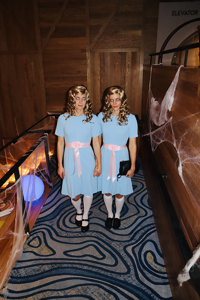 The spooky sisters from The Shining walk down a hallway at W Aspen.