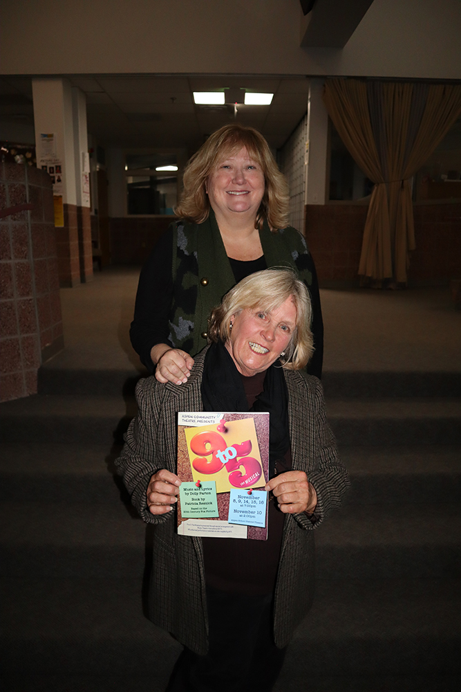 Production staff Mary Sloop (holding the program) and Lynette Schlepp.