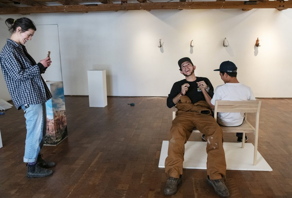 Leah Aegerter, left, takes a picture of Zakriya Rabani, center, and Mark Tan as they test out Tan's piece for the Pairs gallery at Anderson Ranch on Thursday, October 31, 2019. (Kelsey Brunner/The Aspen Times)