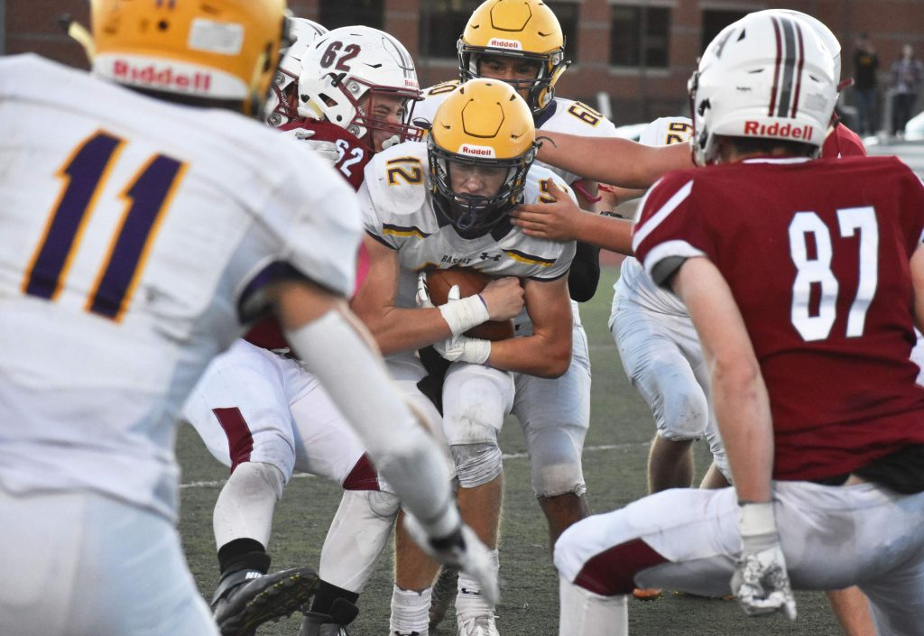 Jackson Rapaport pushes through a pile of TCA defenders during a 2A playoff game. The Longhorns defeated the Titans 13-7 on Saturday, Nov. 10, 2019 in Colorado Springs to advance to the second round of playoffs.
