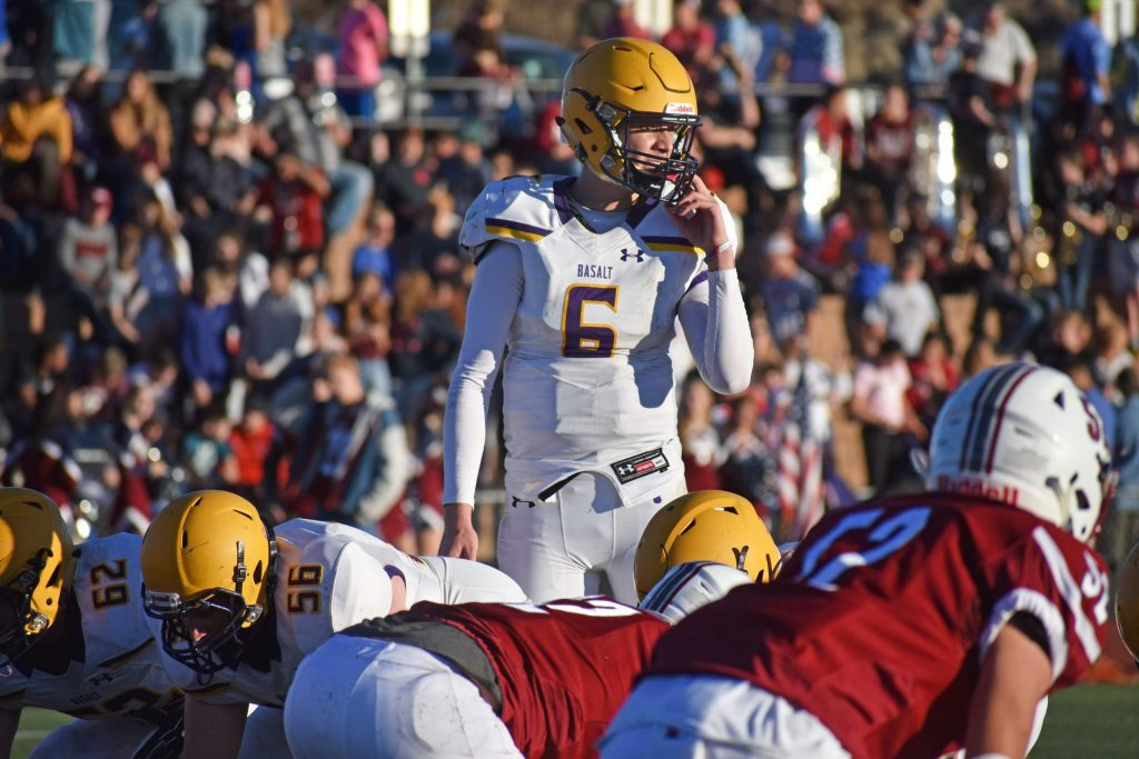 Basalt quarterback Matty Gillis looks to the bench for the playcall during a 2A playoff game against TCA. The Longhorns defeated the Titans 13-7 on Saturday, Nov. 10, 2019 in Colorado Springs to advance to the second round of playoffs.