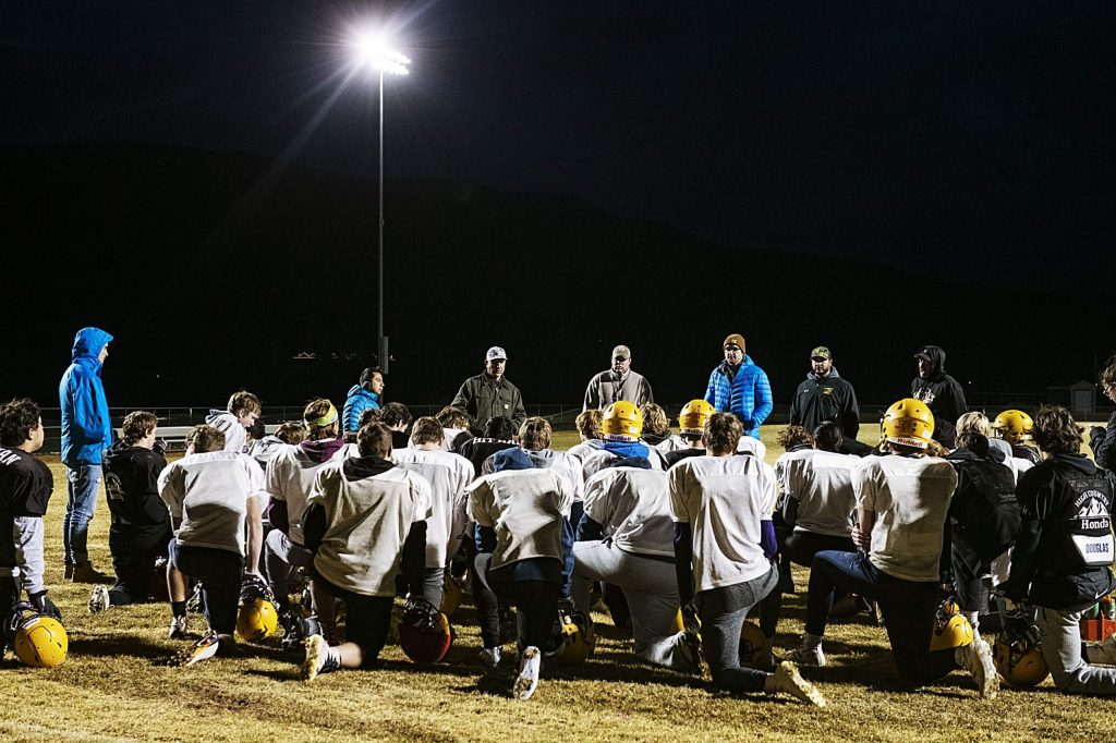 Basalt High School's football team debriefs after an evening practice on their field on Thursday, November 20, 2019. (Kelsey Brunner/The Aspen Times)