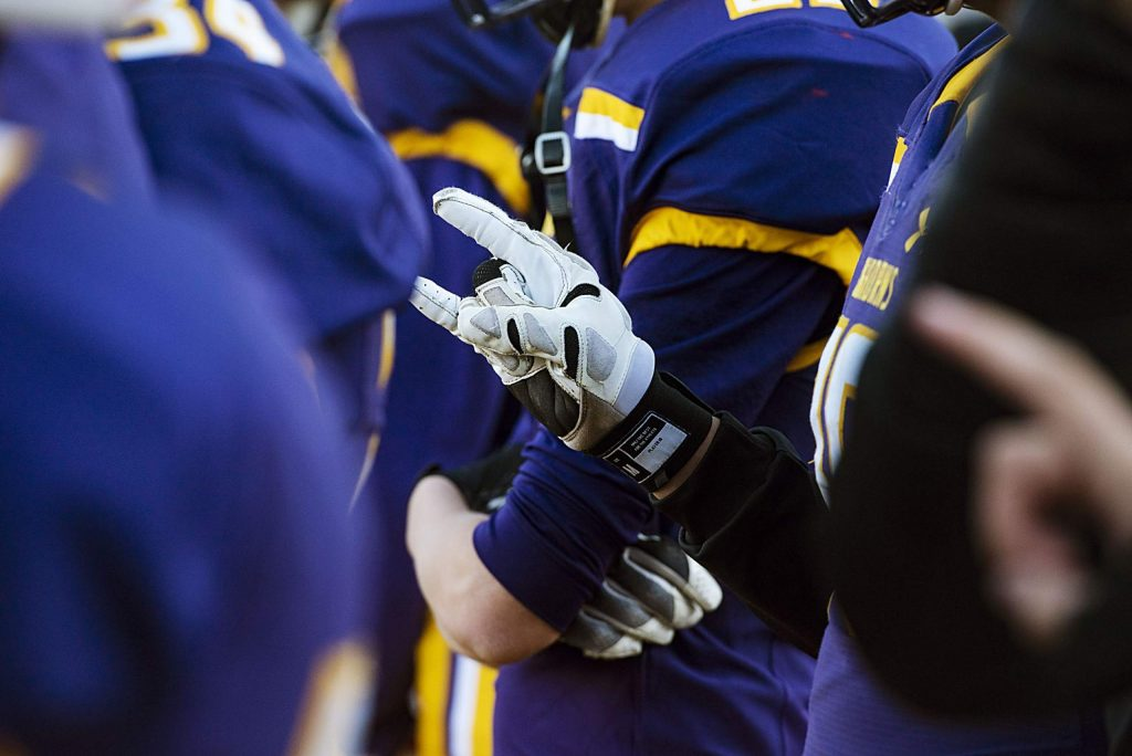 """Basalt High School football players put up """"their horns"""" in the fourth quarter of the semifinal game against Delta High School in Basalt on Saturday, November 23, 2019. (Kelsey Brunner/The Aspen Times)"""
