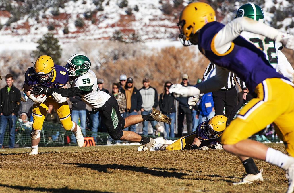 Delta High School's #59 tackles Basalt High School's Cole Dombrowski during the semifinal game in Basalt on Saturday, November 23, 2019. Delta won the game 17-6 and is moving on to the state championship. (Kelsey Brunner/The Aspen Times)