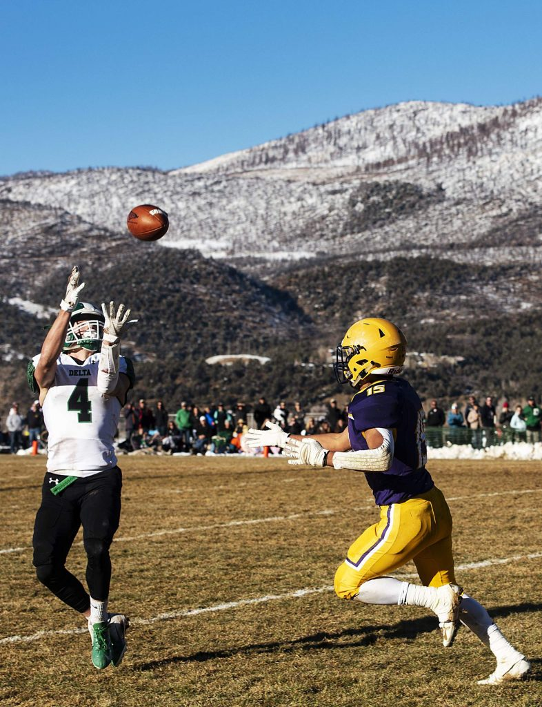 Delta High School's Nathan Workman intercepts a pass meant for Basalt High School's Rulbe Alvarado during the semifinal game in Basalt on Saturday, November 23, 2019. (Kelsey Brunner/The Aspen Times)