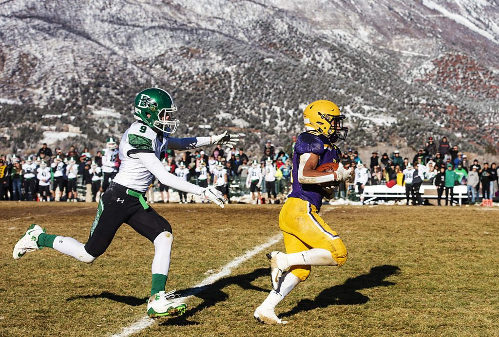 Basalt High School's Rulbe Alvarado runs for a touchdown with Delta High School's Mason Hollowwa in pursuit during the semifinal game in Basalt on Saturday, November 23, 2019. (Kelsey Brunner/The Aspen Times)