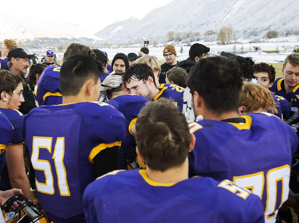 Basalt High School football players comfort each other after an emotional loss of the semifinal game against Delta High School in Basalt on Saturday, November 23, 2019. (Kelsey Brunner/The Aspen Times)