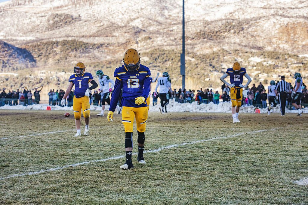 Basalt High School players walk off the field after a play during the semifinal game against Delta High School in Basalt on Saturday, November 23, 2019. (Kelsey Brunner/The Aspen Times)