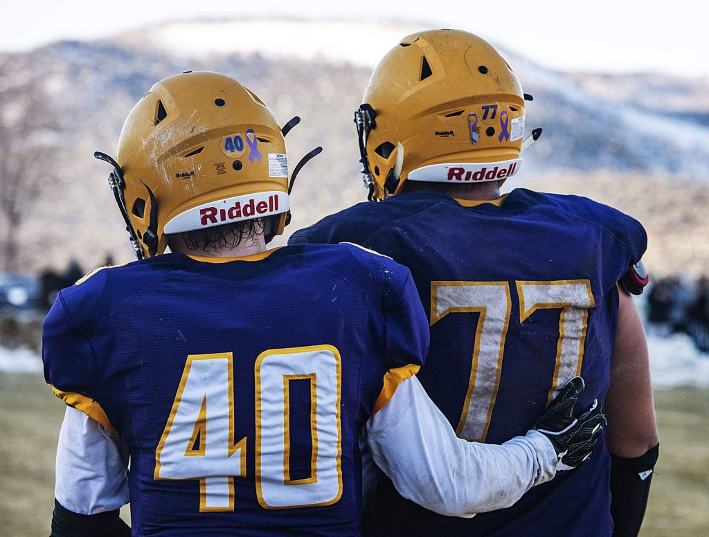 Basalt High School's Trevin Beckman and Ernesto Lopez walk off the field comforting each other after an emotional loss to Delta High School in the semifinal game in Basalt on Saturday, November 23, 2019. (Kelsey Brunner/The Aspen Times)
