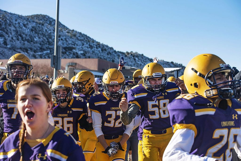 Basalt High School celebrates after their first and only touchdown during the semifinal game against Delta High School in Basalt on Saturday, November 23, 2019. (Kelsey Brunner/The Aspen Times)