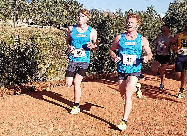 From left, CMC Eagles cross-country runners Caleb Neel and Chris Rohlf race at the last big meet of the season, at the University of Colorado-Colorado Springs. Rohlf ran his fastest 8K of the season in Colorado Springs, at 29:25.6, while Neel ran a two-minute personal record, finishing with a 30:11.6.