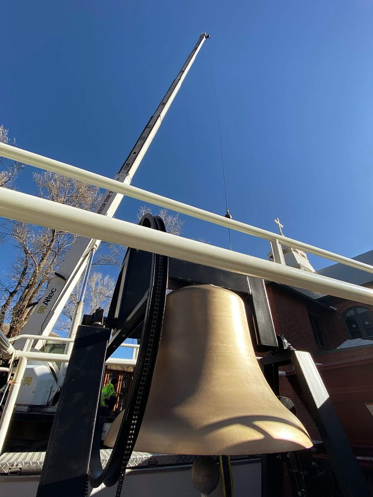 The largest of the three new bells waits Friday morning to be hoisted to the bell tower at St. Mary Catholic Church.