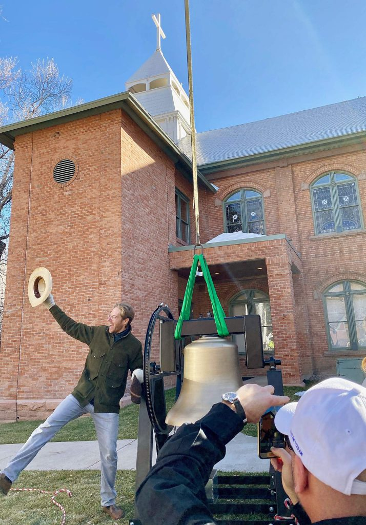 St. Mary music director Kevin Kaukl has his photo taken by Fr. Darrick Leier as the new bell waits to be lifted into the belfry. Fr. Leier recently joined the church after the retirement of Fr. John Hilton.