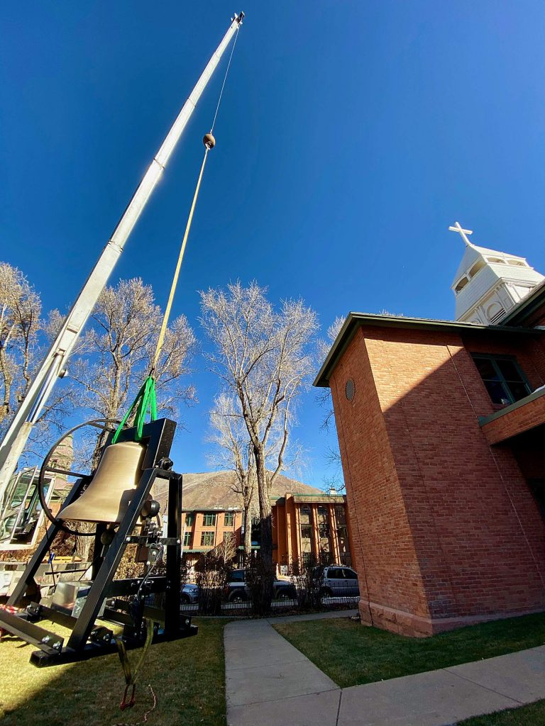 Crews hoisted three new bells into the tower Friday at St. Mary Church in Aspen.