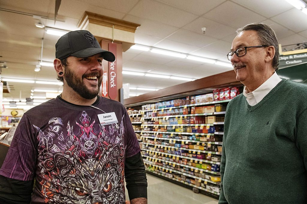 City Market produce manager Jason Zalonis, left, and general manager John Hailey talk in the produce section of the supermarket in Aspen on Tuesday, November 12, 2019. (Kelsey Brunner/The Aspen Times)