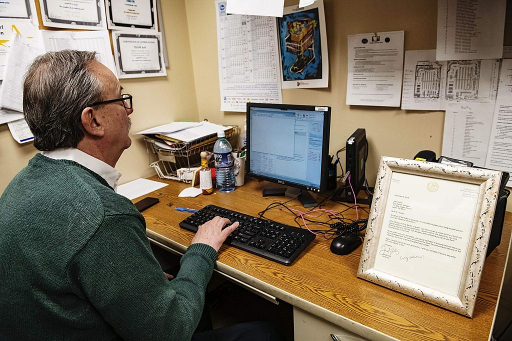 John Hailey sits in his office with a letter from Governor Jared Polis displayed on his desk in Aspen on Tuesday, November 12, 2019. (Kelsey Brunner/The Aspen Times)