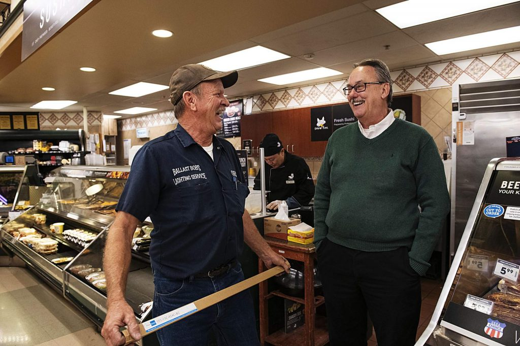 Chris Bennetts, left, and John Hailey talk in the back of the City Market in Aspen on Tuesday, November 12, 2019. Bennetts and Hailey have worked together for over 25 years. (Kelsey Brunner/The Aspen Times)