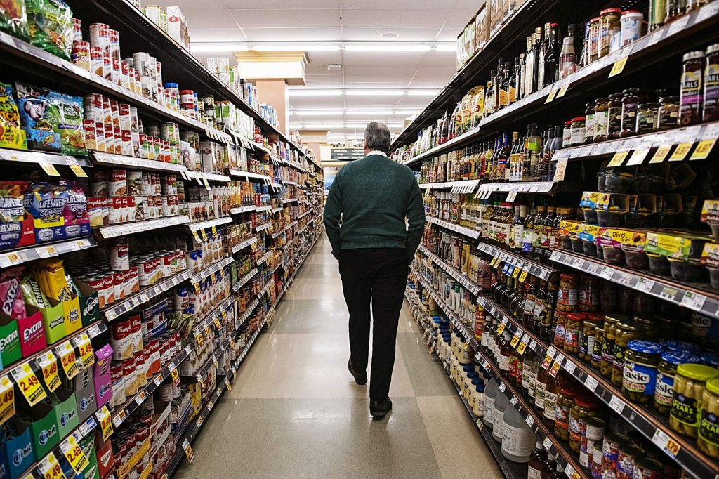 City Market general manager John Hailey walks down aisle four of the supermarket in Aspen on Tuesday, November 12, 2019. (Kelsey Brunner/The Aspen Times)