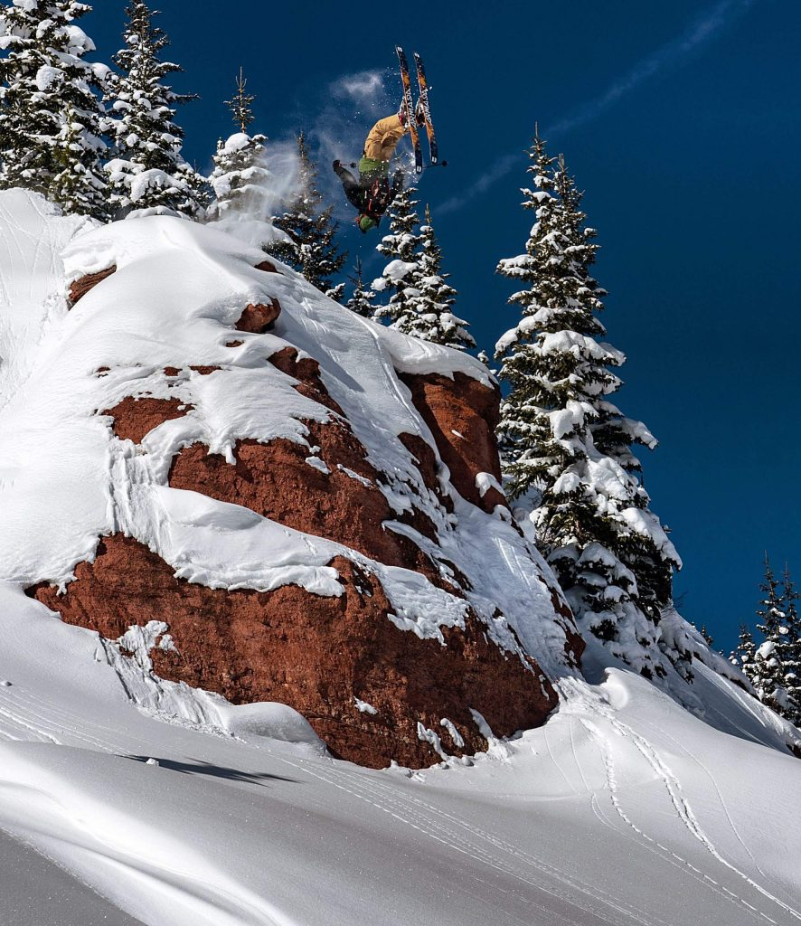 John Spriggs hucks a flip in the Colorado backcountry during filming for