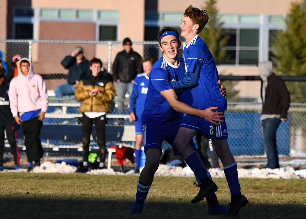 Roaring Fork Rams Ross Barlow and Lucas Schramer celebrate after Barlow's goal early in the second half of Friday night's 3A playoff game against Peak to Peak High School.