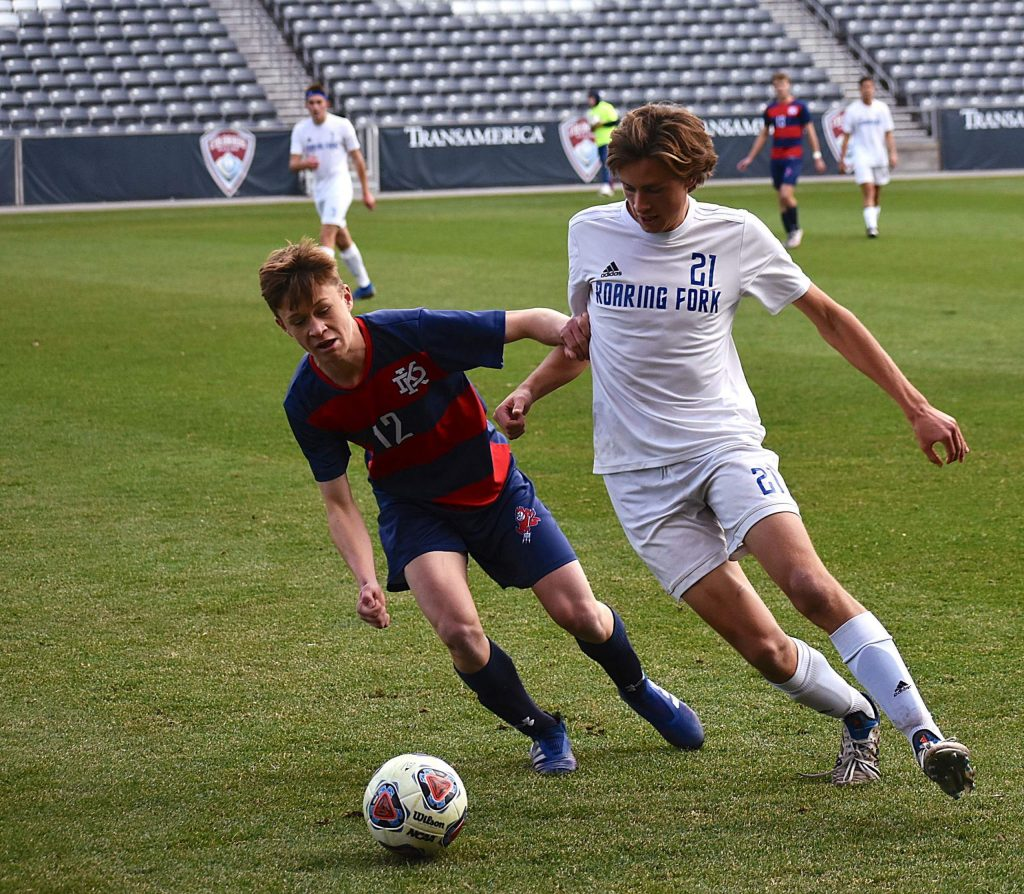 Roaring Fork senior Dylan Webster works to control the ball against Kent Denver's T.J. Gibson during the Rams 5-0 Class 3A title game loss Saturday at Dick's Sporting Goods Park in Commerce City.