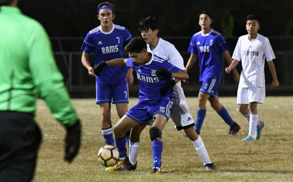 Roarking Fork Ram Junior Mercado fights to keep possession of the ball against the defending Fort Lupton Blue Devils on Tuesday evening.
