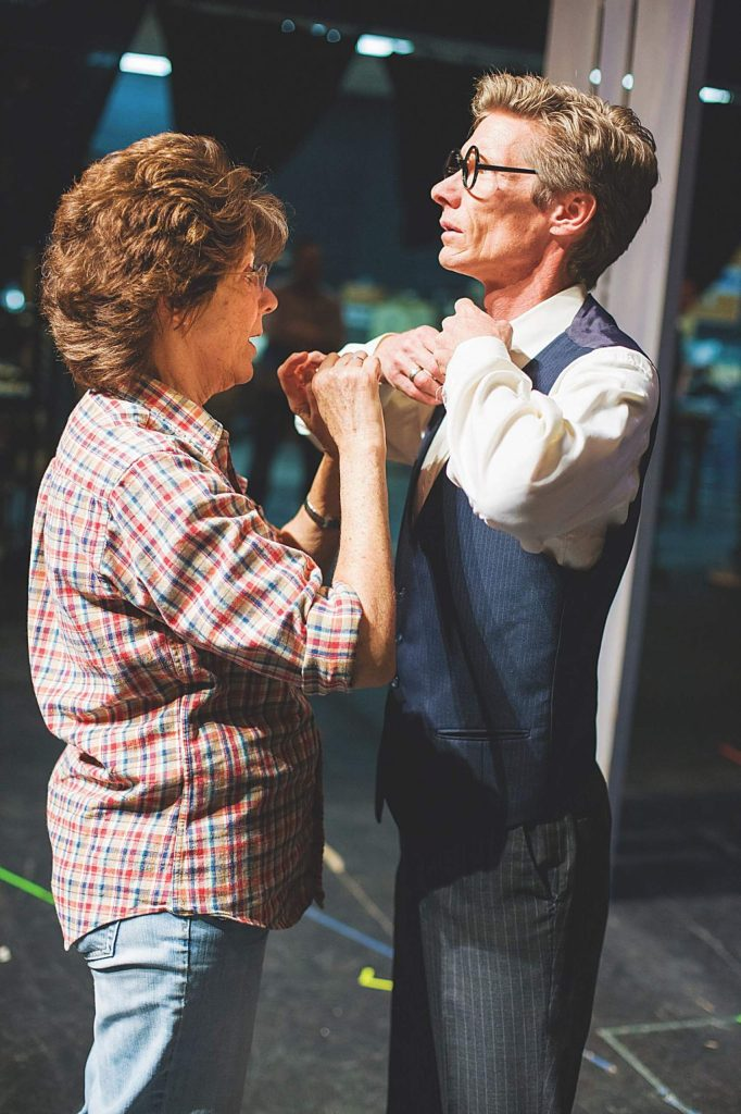 Rita Hunter adjusting John Goss's costume during Aspen Community Theatre's 2012 production of