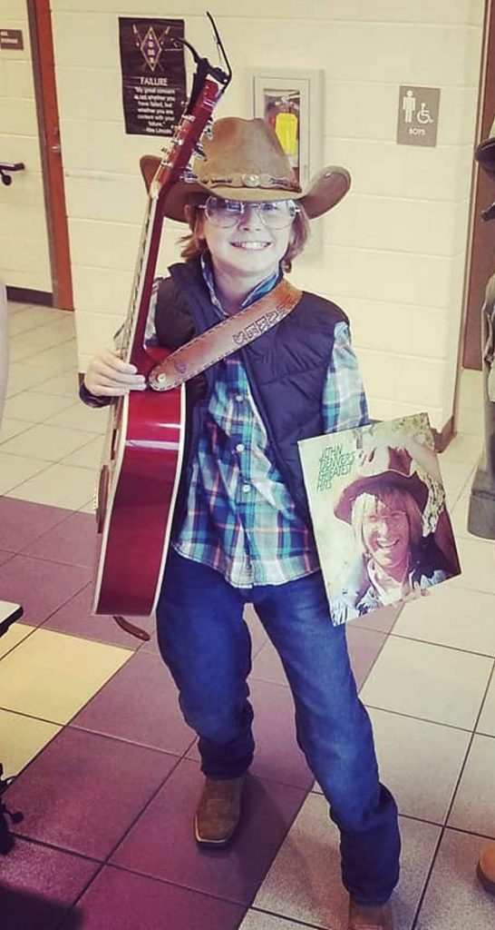 Look familiar? His first name is Denver, given to him by hismother, Brooke Flakes, a big fan of the singer-songwriter who called Aspen home for a better part of his life. This photo was taken in Dahlonega, Georgia, where Denver dressed up as John Denver for a costume contest at his school.
