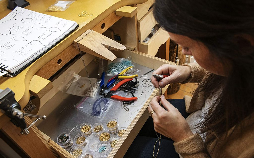 Jewelry artist Caitlin Dunn works on pieces in her studio at the Red Brick Center for the Arts in Aspen on Thursday, November 14, 2019. (Kelsey Brunner/The Aspen Times)