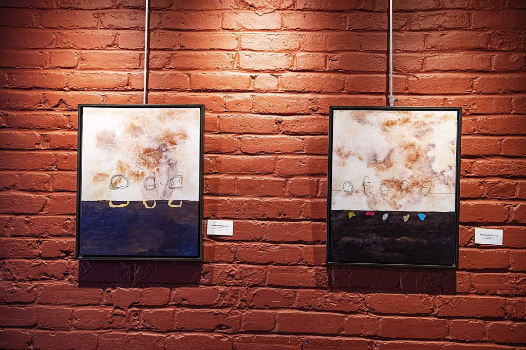 Paintings by Michael McConnell hang at the Red Brick Center for the Arts for the Resident Artists Exhibition in Aspen on Thursday, November 14, 2019. (Kelsey Brunner/The Aspen Times)