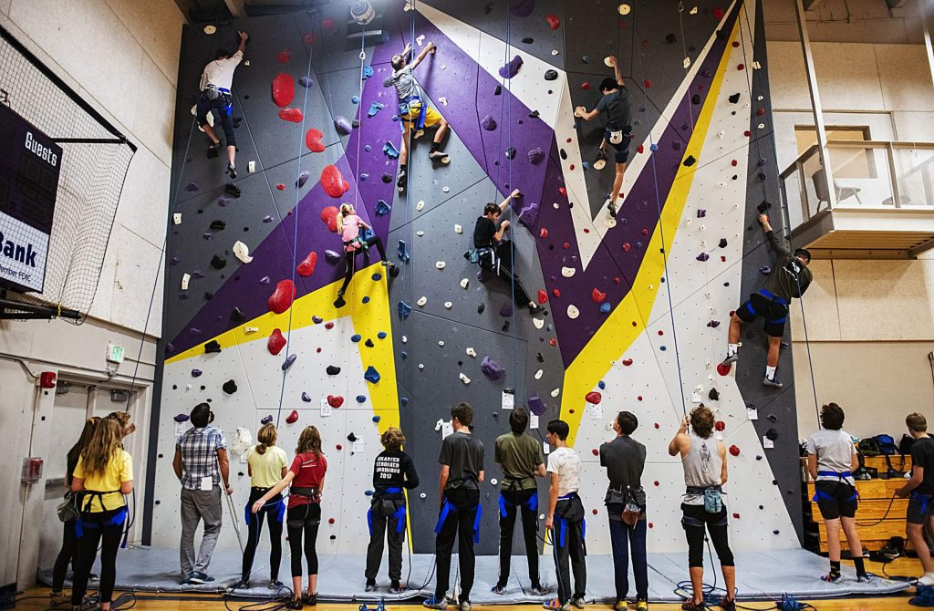 Members of the Basalt High School climbing team run laps on their climbing wall in the gym of the school on Wednesday, Nov. 6, 2019.